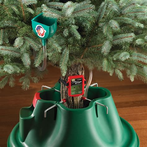 the musical christmas tree watering reminder hammacher