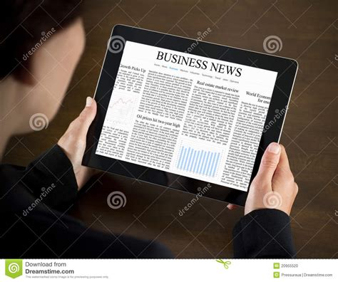 reading on tablet reading business news on tablet pc stock photo image