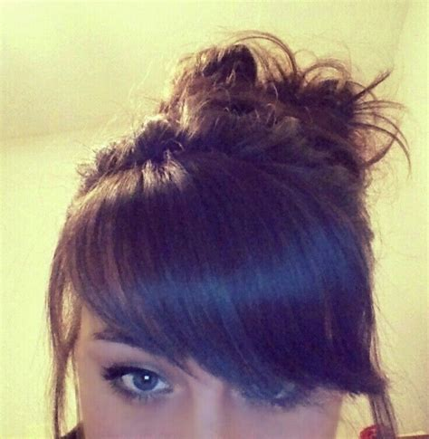 images of a messy bun with bang no hair out thick side swept bangs and messy bun did my bangs myself