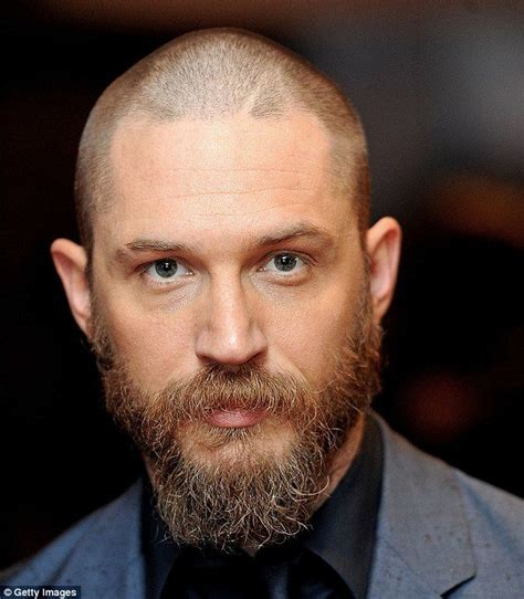 tom hardy eye color tom hardy unveils drastic buzz cut and beard at premiere