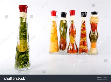 Decorative Bottles With Vegetables In Vinegar by Decorative Glass Bottles Filled With Colorful Fruits