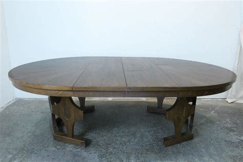 expanding round dining room table 1960s mid century expandable round walnut dining table at