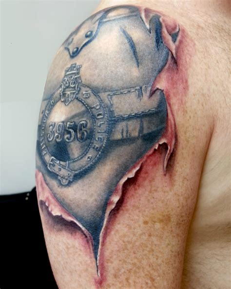 bio mech police shoulder tattoo venice tattoo art designs