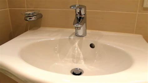 bathtub tap dripping close up of dripping water in bathroom sink stock footage