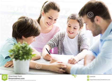 Mother Daughter House Plans family doing homework together at table stock photo