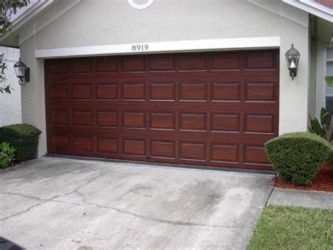 paint a metal garage door to look like wood everything i december 2011 everything i create paint garage doors
