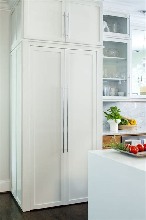 refrigerator behind cabinet doors hidden pantry transitional kitchen terracotta studio