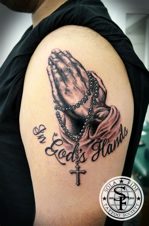 praying hands black and gray arm tattoo sola fid 233 tattoo