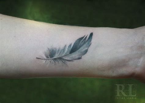 feather tattoo on wrist meaning best 25 feather meaning ideas on