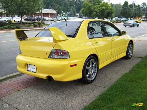 mitsubishi yellow blue mitsubishi lancer evo or yellow pictures