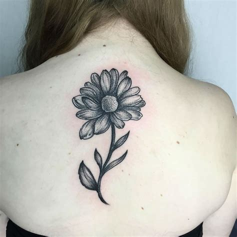 24 photos of cheerful daisy tattoos
