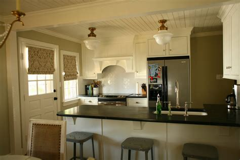 urban grace interiors cottage and vine roman shades in the kitchen