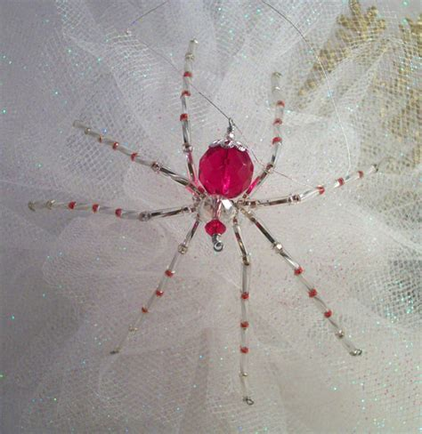 red glass spider christmas ornament with by thespiderlady