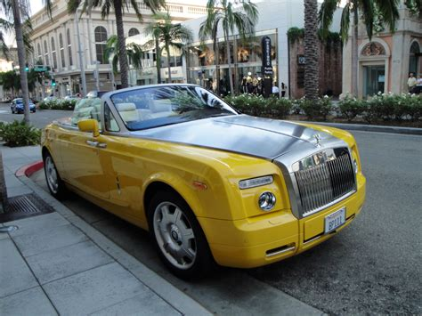 roll royce yellow rolls royce phantom drophead coupe zero to 60 times