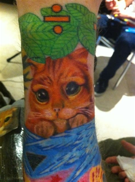 ed sheeran new tattoo tiger why ed sheeran has a puss in boots tattoo i ll never know