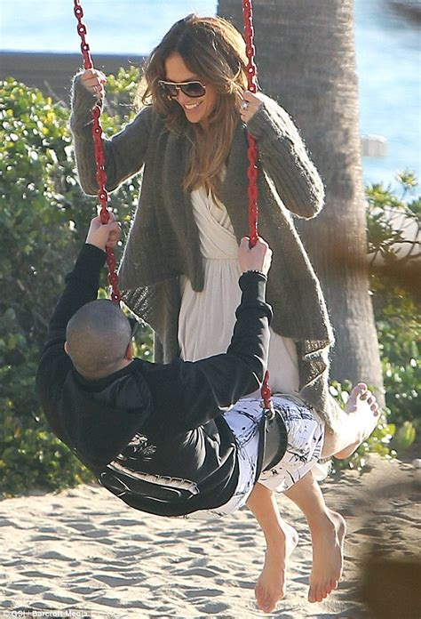 how much is a sex swing jennifer lopez is like a giddy teenager as she and toy boy