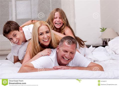 fun in bed family having fun in bed royalty free stock photography