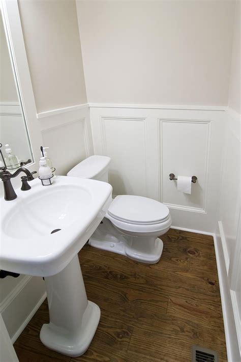bathroom brown wood floor ideas  chic wainscoting