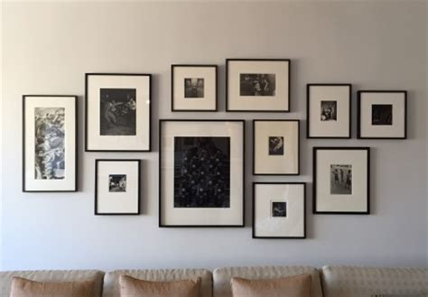 hanging pictures over sofa how to arrange art above your sofa