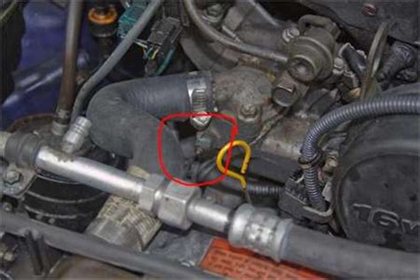 solved: where is the coolant temp sensor on a suzuki grand