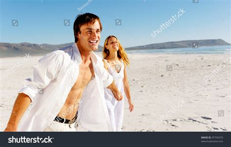 tune honeymoon quiz romantic honeymoon couple walk on the beach during a
