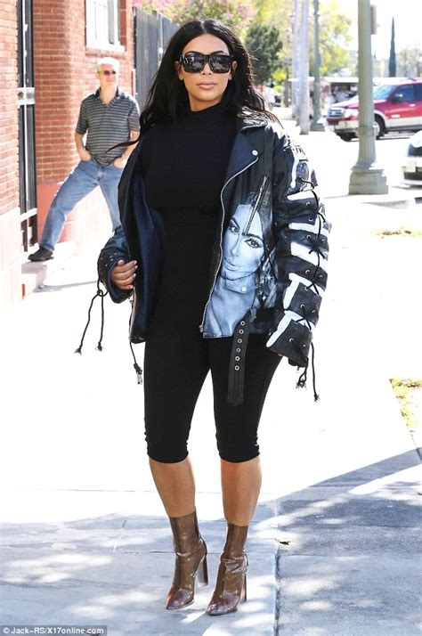 for once kim kardashian stepped out in an outfit we didnt want to kim kardashian steps out in yeezy perspex boots and spray