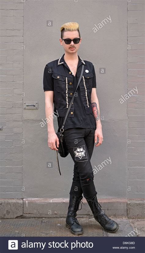 village tattoo nyc new york ny a young man in unusual dress with a david bowie tattoo in
