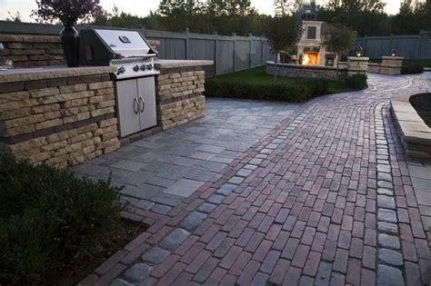 Unilock fireplace outdoor kitchen patio walkway wall