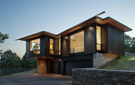 Appalachian Mountains with dark wood garage doors exterior