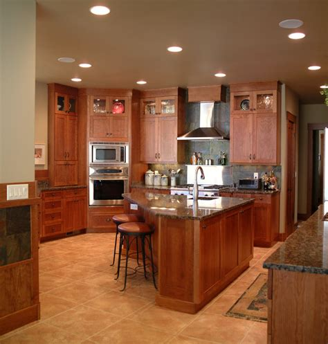 kitchen triangle with island craftsman style kitchen with cherry cabinets traditional