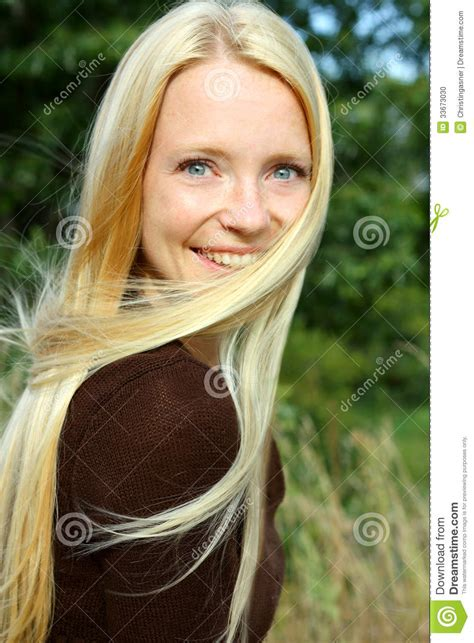 blonde hairs styles for 33 year old woman woman in nature with blowing hair stock photo image
