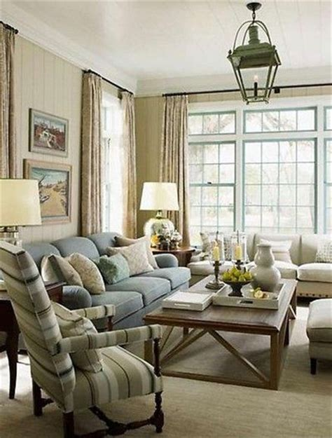 light sage green living room with blue accents relaxing sr gambrel living room sage green walls light blue sofa