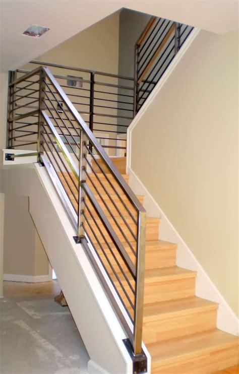 modern neutral wooden staircase with minimalist steel