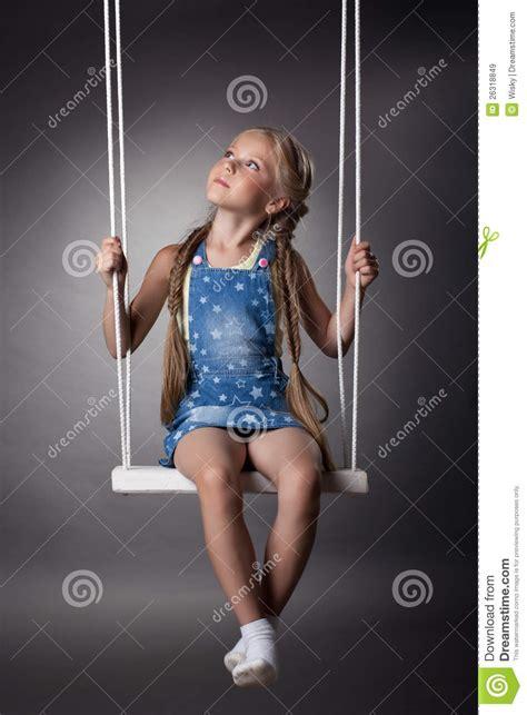 sitting swing beautiful girl sitting on swing royalty free stock images