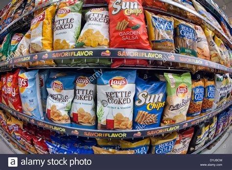 Frito Lay Racks by A Display Of Tasty Frito Lay Chips And Other Snacks In A