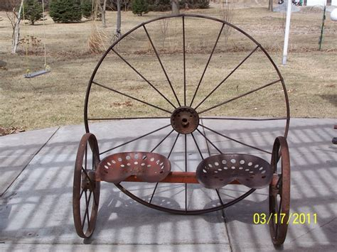 wagon wheel bench seat antique wagon wheel tractor seat garden bench flower