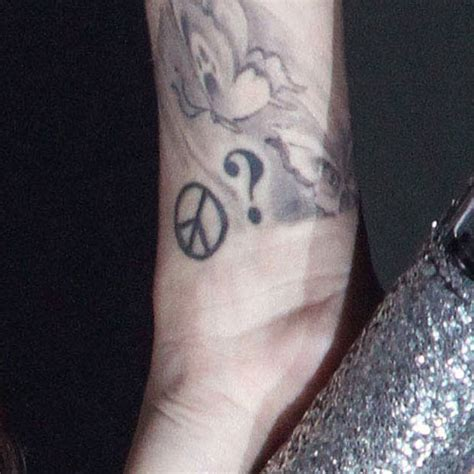 question mark tattoo on wrist meaning cher lloyd peace sign question mark wrist tattoo steal