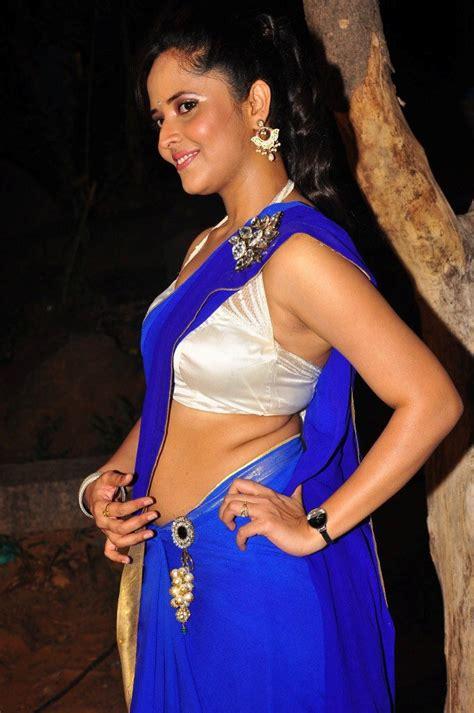 tv anchor anasuya latest hot blue saree images beautiful south spice anasuya hot in blue saree
