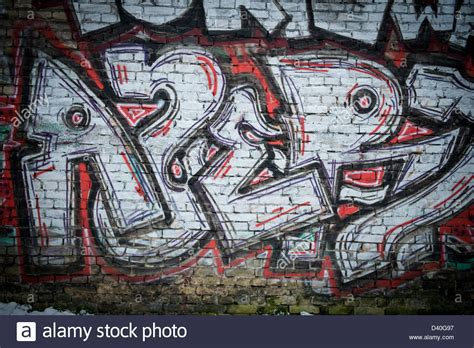 spray paint wall a graffiti spray painted brick wall using black and