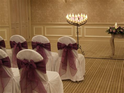 wedding chair covers wirral crystal flowers wedding chair covers organza bows to