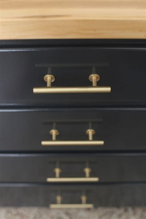 gold kitchen cabinet hardware black lower cabinets with gold hardware and butcher block