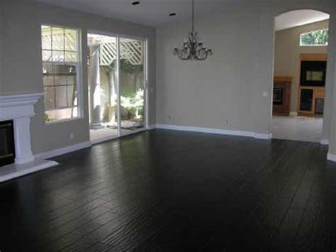 Black Hardwood floor to match stone fireplace, grey/yellow