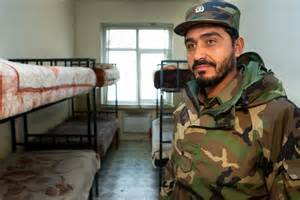 army room file an afghan national army soldier stands by a typical