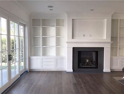 built in cabinets around fireplace amber interiors built in shelving around fireplace cut