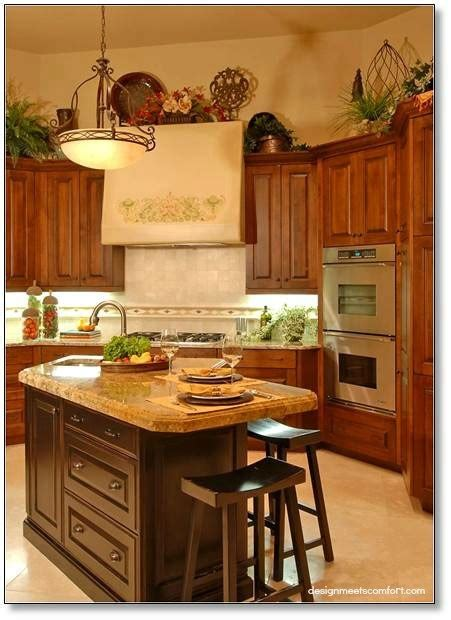 decorate above kitchen cabinets how to decorate above your kitchen cabinets design by