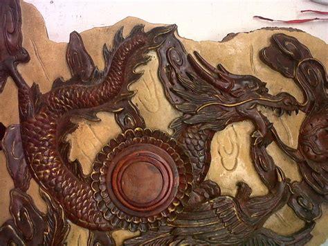 Tinta Naga artefak ukiran jati antik naga dan