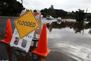 warning signs after ac section photos show much needed rain falling over california and