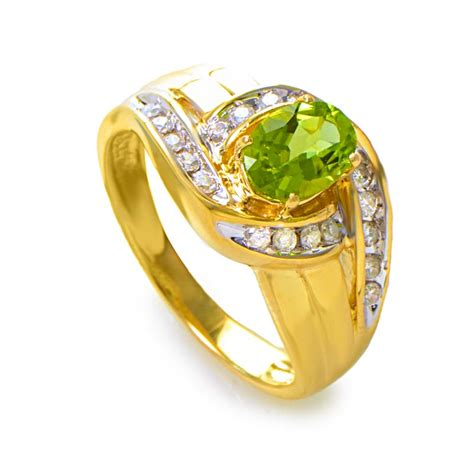 rings 14k yellow gold large peridot gemstone and