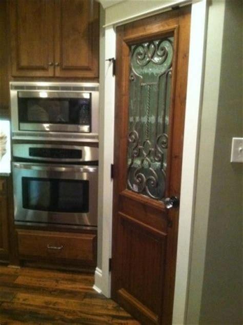 Iron Pantry Door by Wrought Iron Inset Used On Pantry Door Custom Doors