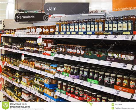 On A Shelf Stores by Jars Of Jelly Or Jam On A Superstore Shelf Editorial
